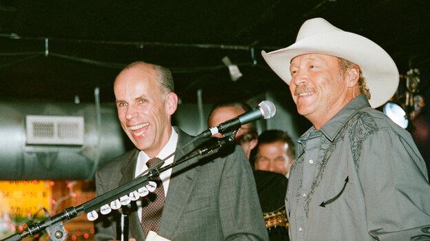 Eddie Stubbs (left), DJ at Nashville's WSM, and Alan Jackson onstage at The Station Inn last Tuesday.