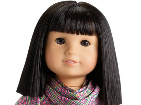 "For $110, you can buy a doll of Ivy Ling — ""Julie's best friend"" — and her ""dark, almond-shaped eyes that open and close."""
