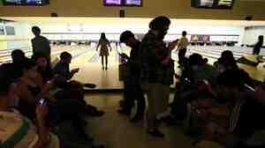Bowling alley scene.