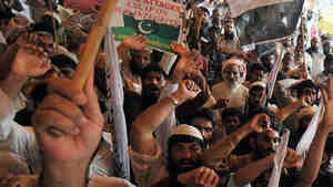 Protesters in Pakistan shout anti-U.S. slogans during a protest in July against drone strikes in Pakistan's tribal areas.