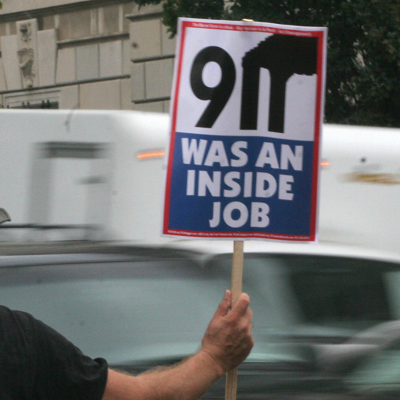 A protester in Washington, D.C., holds a sign claiming the Sept. 11 attacks were an inside job, in 2007.
