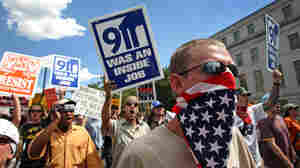 Conspiracy theorists and other protesters march through downtown Denver on Aug. 26, 2008.