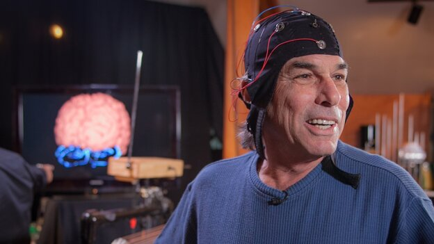 Musician Mickey Hart in a cap that collects electrical activity in his brain.