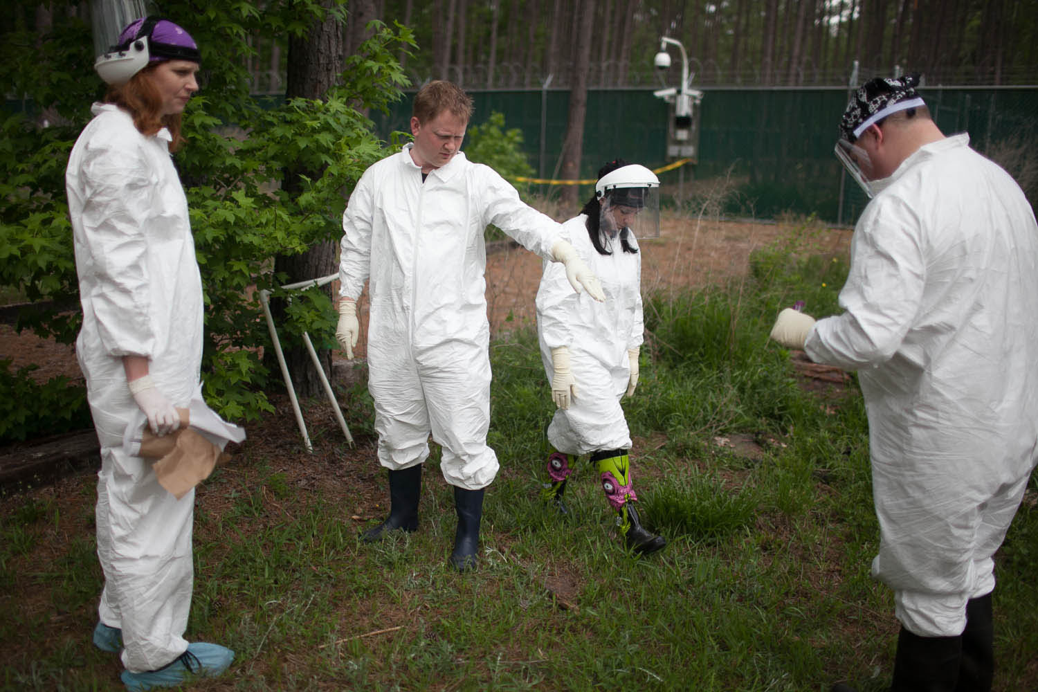 From left, researchers Jessica Metcalf, Aaron Lynne, Bucheli and Daniel Harmaan mark the precise spot to place a fresh body.