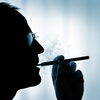 A man smokes an electronic cigarette.