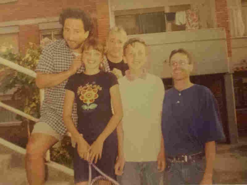 Leo del Aguila (from left), Vesa Gashi, Scott Simon, Erblin Mehmetaj and Shawn Fox in 1999 in a housing complex in Pristina. Del Aguila, Simon and Fox were covering the Kosovo conflict for NPR; the children lived in the war-stricken area.