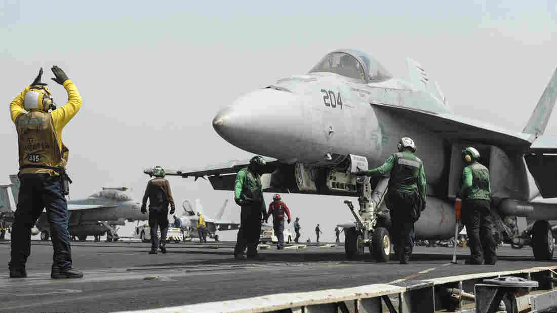 A U.S. Navy F/A-18F Super Hornet prepares to launch from the aircraft carrier USS Nimitz earlier this week in the Red Sea. The ship is among U.S. military assets in the region.