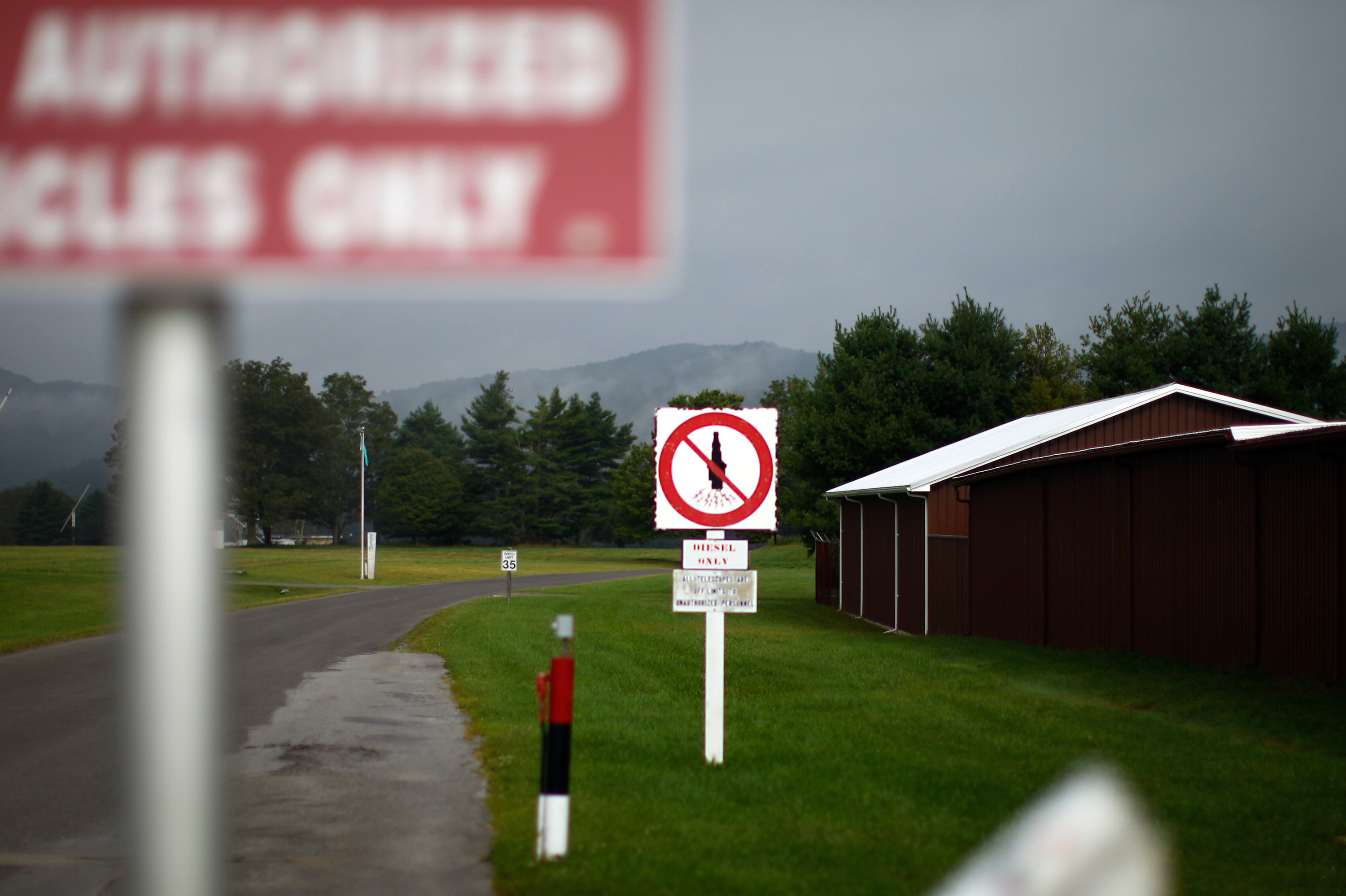 A series of signs and roadblocks mark the farthest point visitors can move toward the NRAO. Even spark plugs can disrupt the telescopes after this point, so old diesel trucks without plugs are used to drive in the zone.
