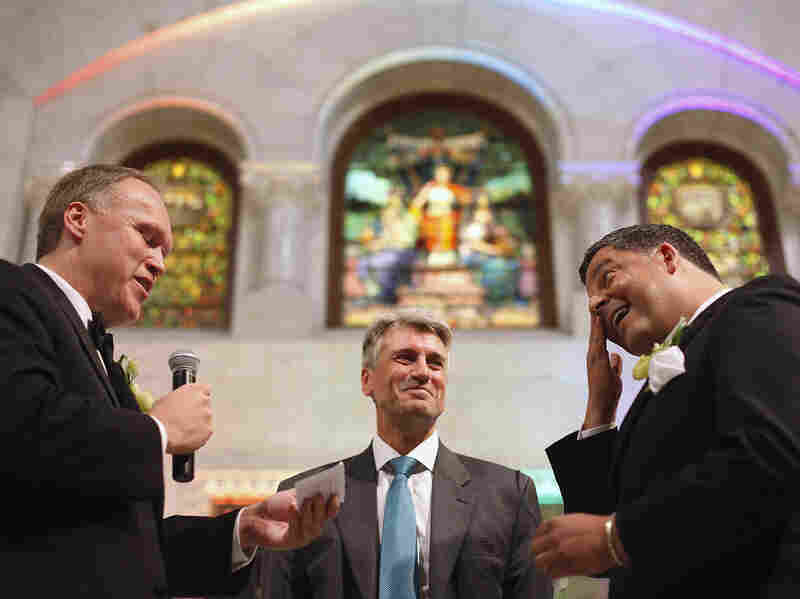 "Minneapolis Mayor R.T. Rybak officiates at the wedding of Al Giraud, right, and his partner Jeff Isaacson at the Minneapolis City Hall on Aug. 1. Rybak is now on the road launching a ""Marry in Minneapolis"" campaign."