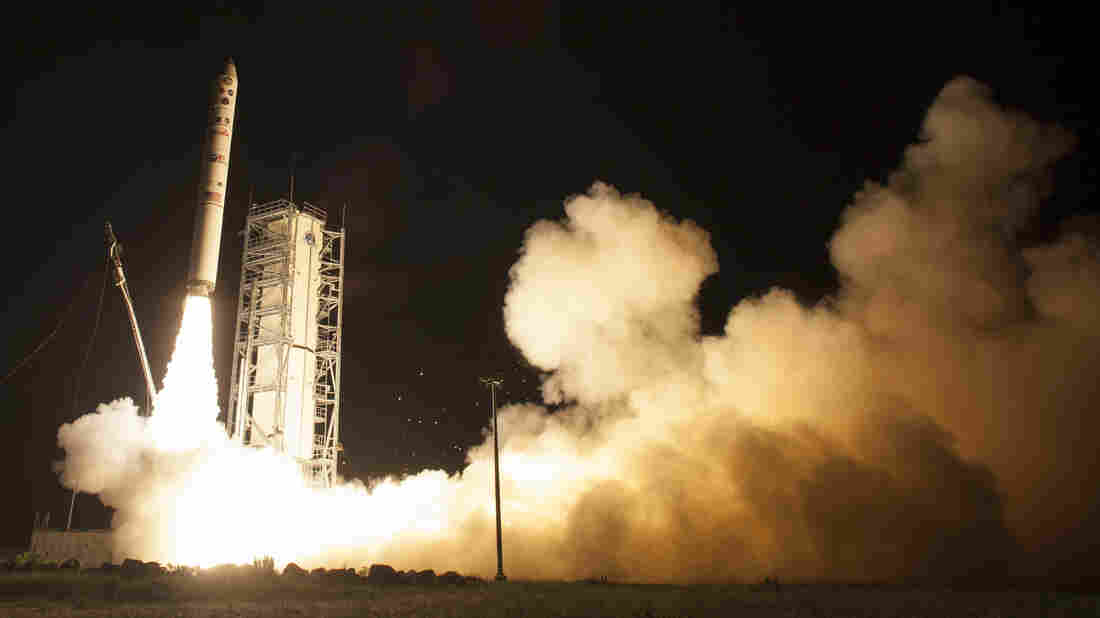 An unmanned Minotaur rocket carries NASA's newest robotic explorer, the LADEE spacecraft, into Earth orbit and then to the moon.