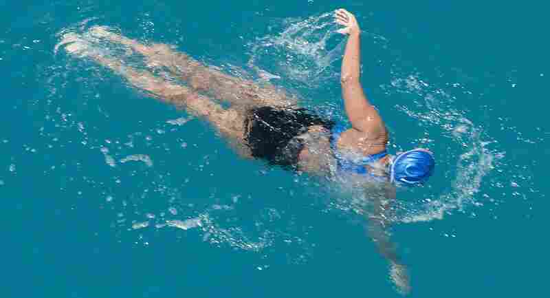 Diana Nyad swims less than two miles off Key West, Fla., on Monday.