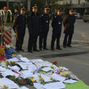 Security guards stand outside newspaper offices in Guangdong province in January, where banners and flowers were laid in protest of censorship.