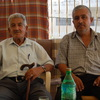 Ahmed al-Hurani, left, and his son, Bassam, live in the West Bank. Eleven members of their family living in Syria died in the chemical attack on Aug. 21.