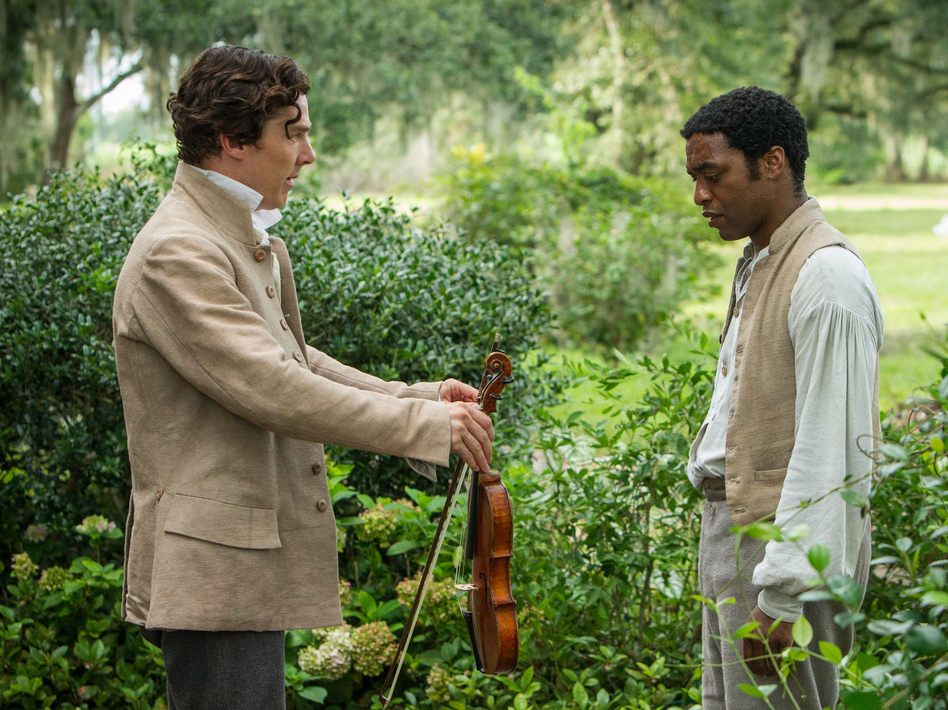 Chiwetel Ejiofor (right) plays Solomon Northup in <em>12 Years A Slave</em>. Benedict Cumberbatch plays one of the slaveowners who claim ownership of him.