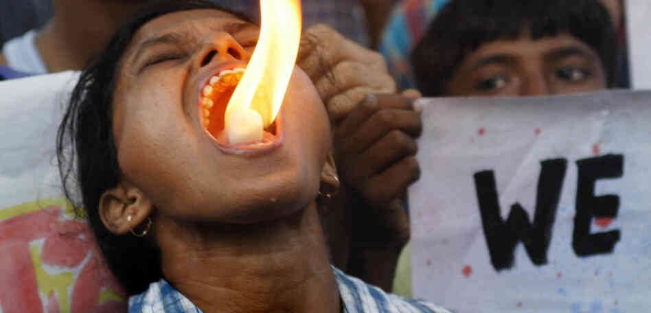 Fire breathing only makes it harder to talk: An activist with the Science and Rationalists' Association of India demonstrates against the claim that Mother Teresa performed a miracle in Calcutta.