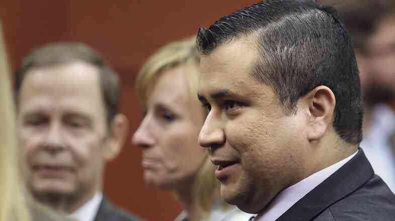 George Zimmerman leaves court with his family after a jury found him not