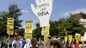 Protesters against U.S. military action in Syria march to Capitol Hill from the White House on Saturday.