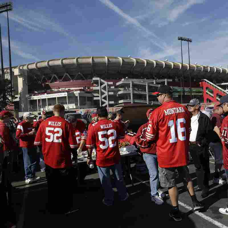 Fans tailgate outside Candlestick Park in 2012.