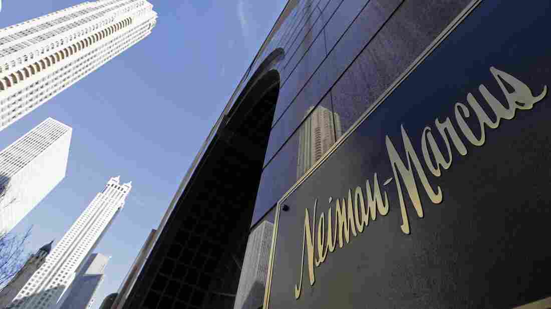 The Chicago skyline is reflected in the exterior of Neiman Marcus on Michigan Avenue in Chicago in a file photo from 2009. The luxury retailer sold for six billion dollars on Monday.