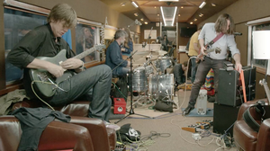 Sonic Youth's Thurston Moore (left) jams with drummer John Moloney, Ariel Pink and friends aboard the Station To Station train.