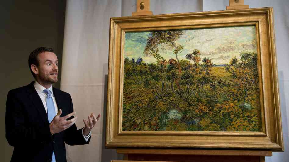 Alex Ruger, director of the Van Gogh Museum in Amsterdam, at the unveiling Monday of Vincent Van Gogh's Sunset at Montmajour.