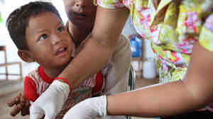 A Cambodian boy gets tested for malaria at a clinic along the Thai-Cambodian border in 2010. Three strains of drug-resistant malaria have emerged from this region over the past 50 years.