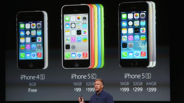 Phil Schiller, Apple's senior vice president of worldwide marketing, speaks about pricing for the new iPhone during an Apple product announcement on Tuesday. (Getty Images)