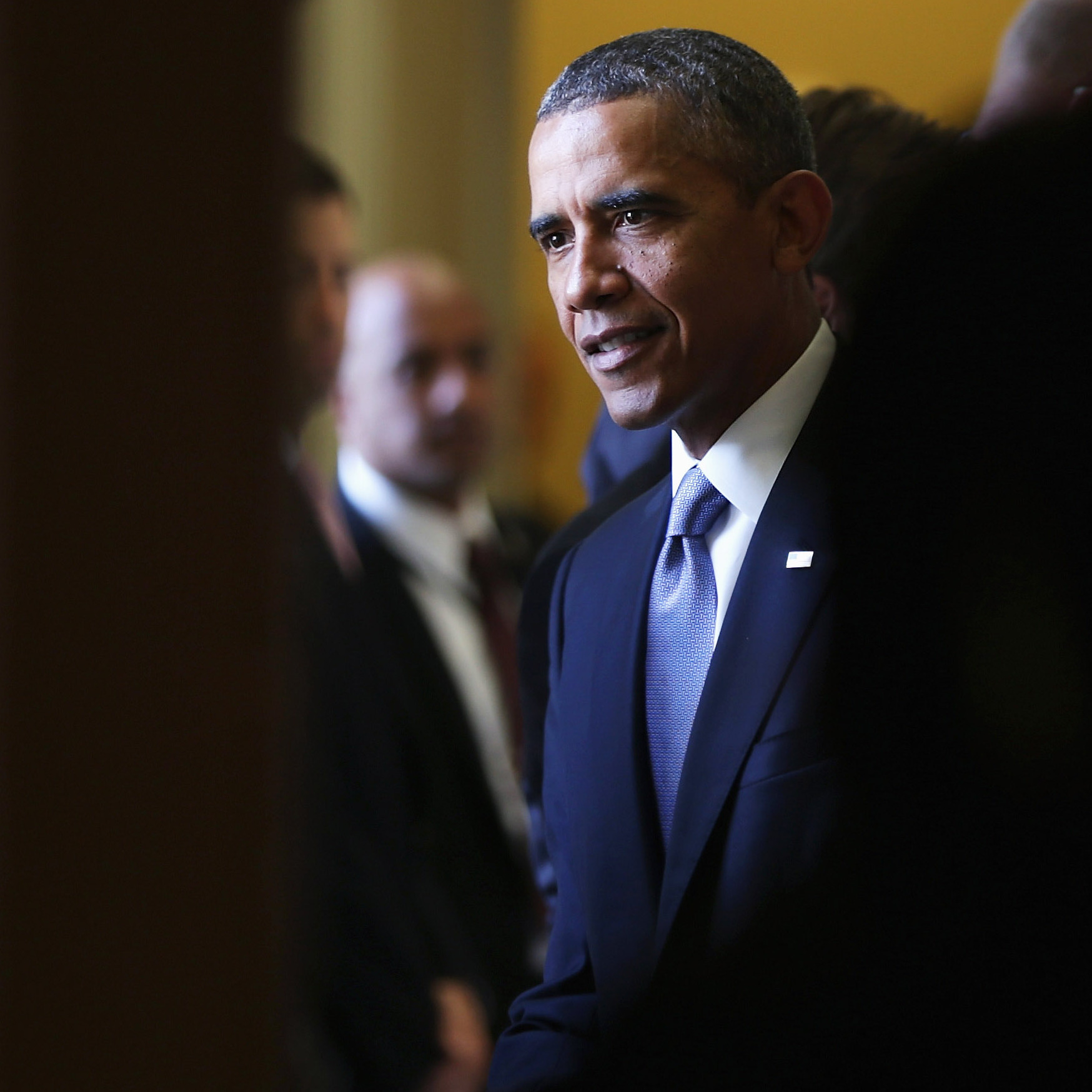 President Obama talks to Senate pages as he leaves the Senate Democratic policy luncheon after meeting with Senate Democrats at the Capitol on Tuesday.
