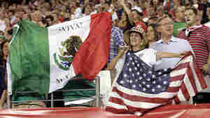 Fans wave the flags of Mexico and the United States before a friendly soccer match in Philadelphia in 2011. The match ended in a 1-1 tie.