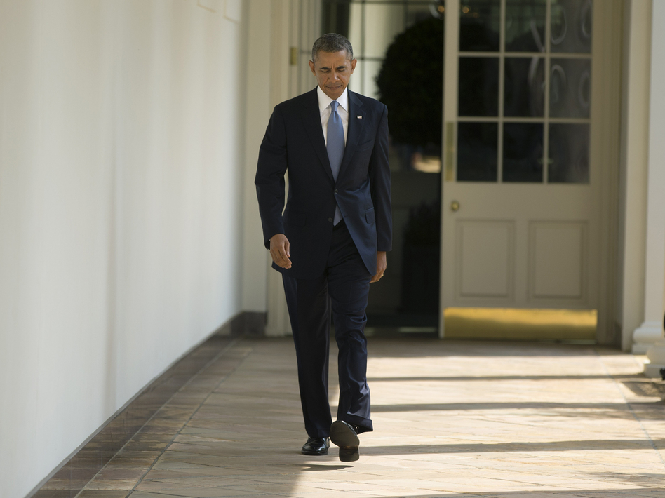 President Obama walks toward the Oval Office of the White House on Tuesday.