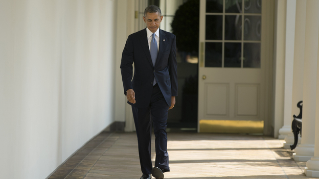 President Obama walks toward the Oval Office of the White House on Tuesday. (AP)