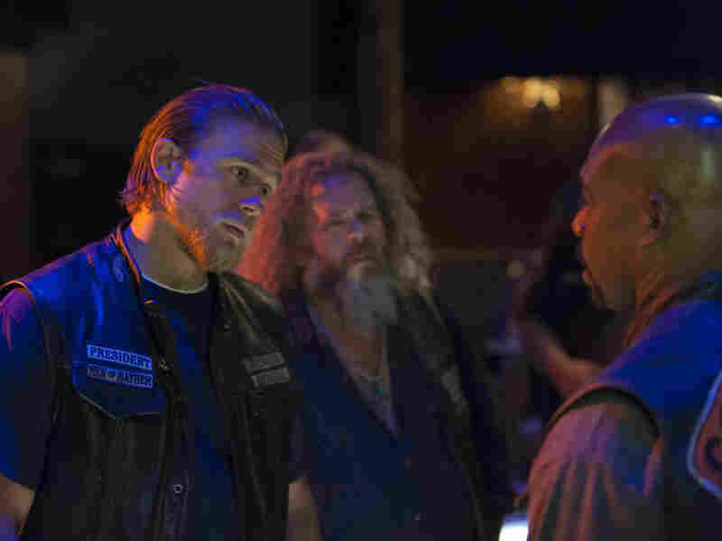 Charlie Hunnam (left) with Mark Boone Jr. and Michael Beach, in an episode of Sons of Anarchy. Don't you just feel a cuss coming on?