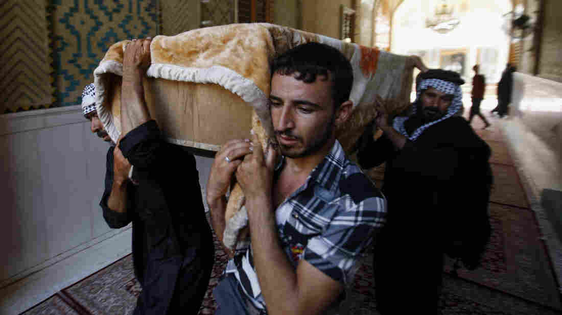 Mourners carry the coffin of a car bomb victim during the funeral in the Shiite holy city of Najaf, Iraq, last week. Violence is on the rise in Iraq, but it is receiving little international attention.