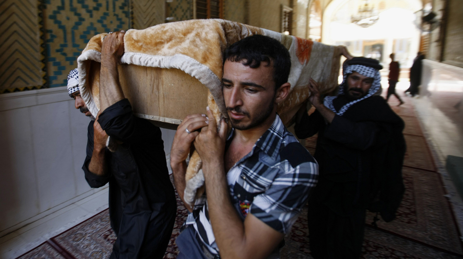 Mourners carry the coffin of a car bomb victim during the funeral in the Shiite holy city of Najaf, Iraq, last week. Violence is on the rise in Iraq, but it is receiving little international attention. (AP)