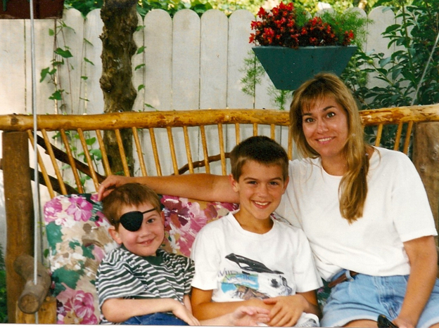Hayden Strum (left) with his older brother, Gunnar, and their mom, Kathleen, in 1998.