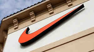 "The Nike ""swoosh"" on a store in Orlando, Fla."