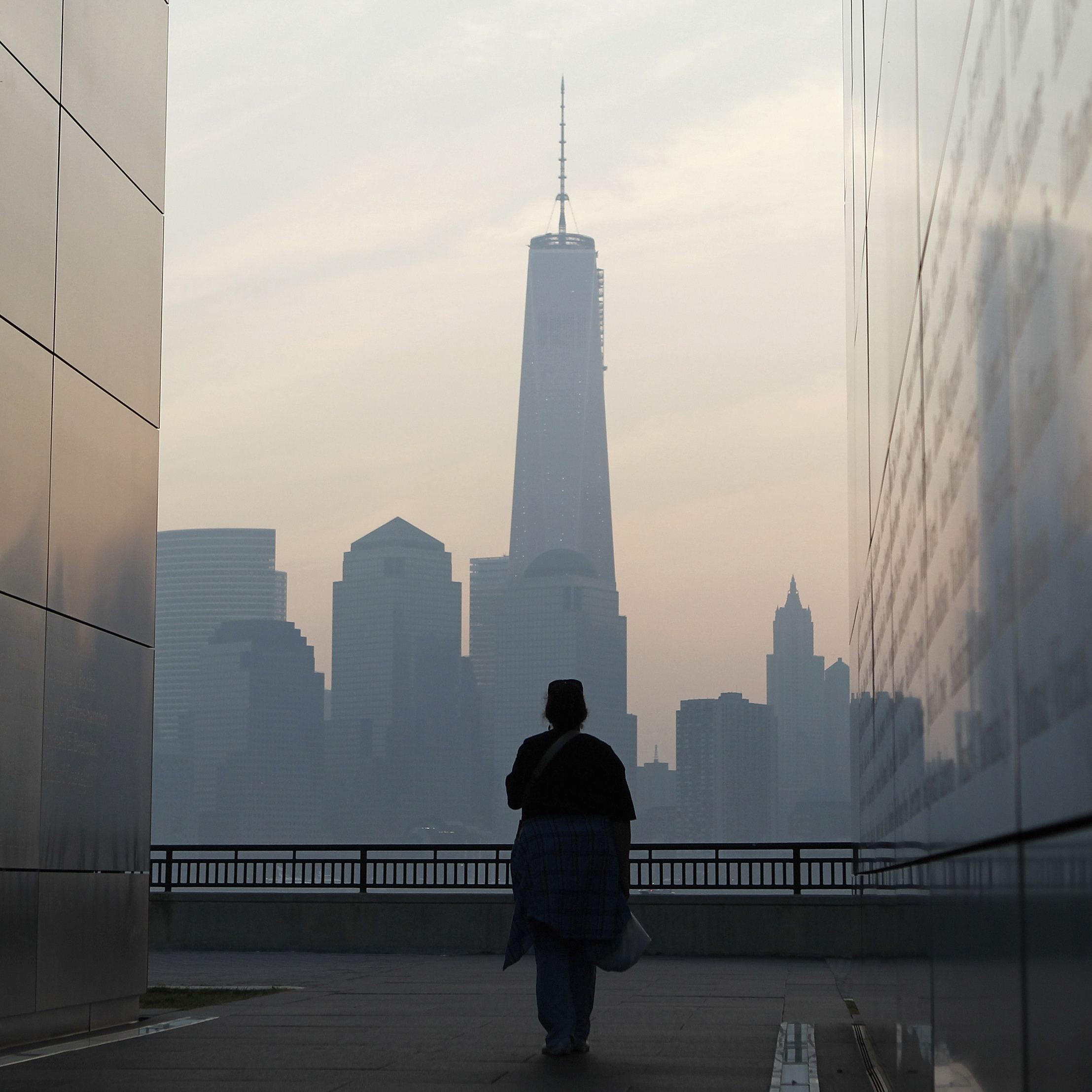 A woman looks out at One World Trade Center from inside the 9/11 Empty Sky memorial at Liberty State Park in Jersey City, N.J., on Wednesday. Americans commemorated the 12th anniversary of the Sept. 11 attacks with solemn ceremonies and pledges to not forget the nearly 3,000 people killed.