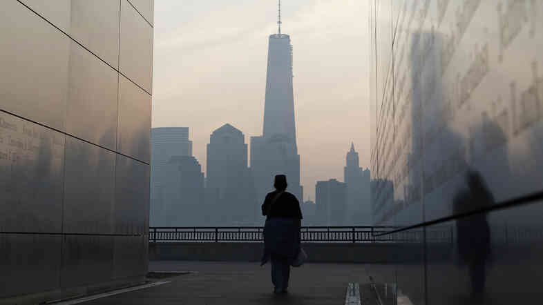 A woman looks out at One World Trade Center from inside the 9/11 Empty Sky memorial at Liberty State Park in Jersey City, N.J., on Wednesday. Americans commemorated the 12th anniversary of the Sept. 11 attacks with solemn ceremonies and pledges to not forget the nearly 3,0