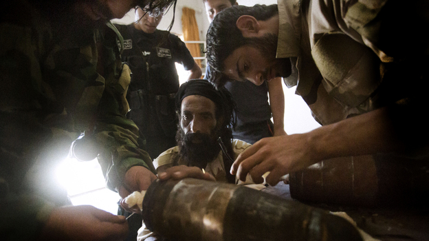 Rebel fighters prepare explosive devices to be used during fighting against Syrian government forces on September 7, 2013 in Syria's eastern town of Deir Ezzor. (AFP/Getty Images)