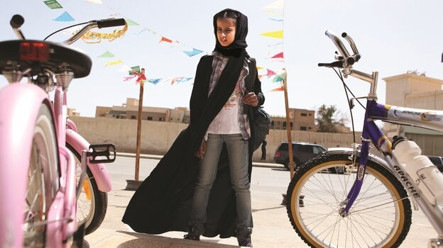 All Wadjda (Waad Mohammed) wants is her own bicycle — but as Haifaa Al Mansour's film illustrates, that's a tricky proposition for a young girl living in Saudi Arabia.