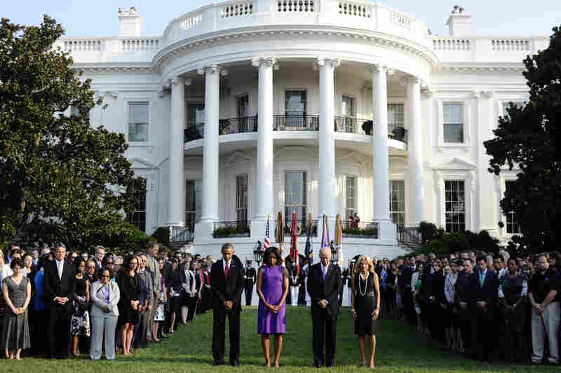 President Obama, first lady Michelle Obama, Vice President Joe Biden and Jill Biden observe a moment of silence to mark the 12th anniversary of the 9/11 attacks on the South Lawn of the White House.