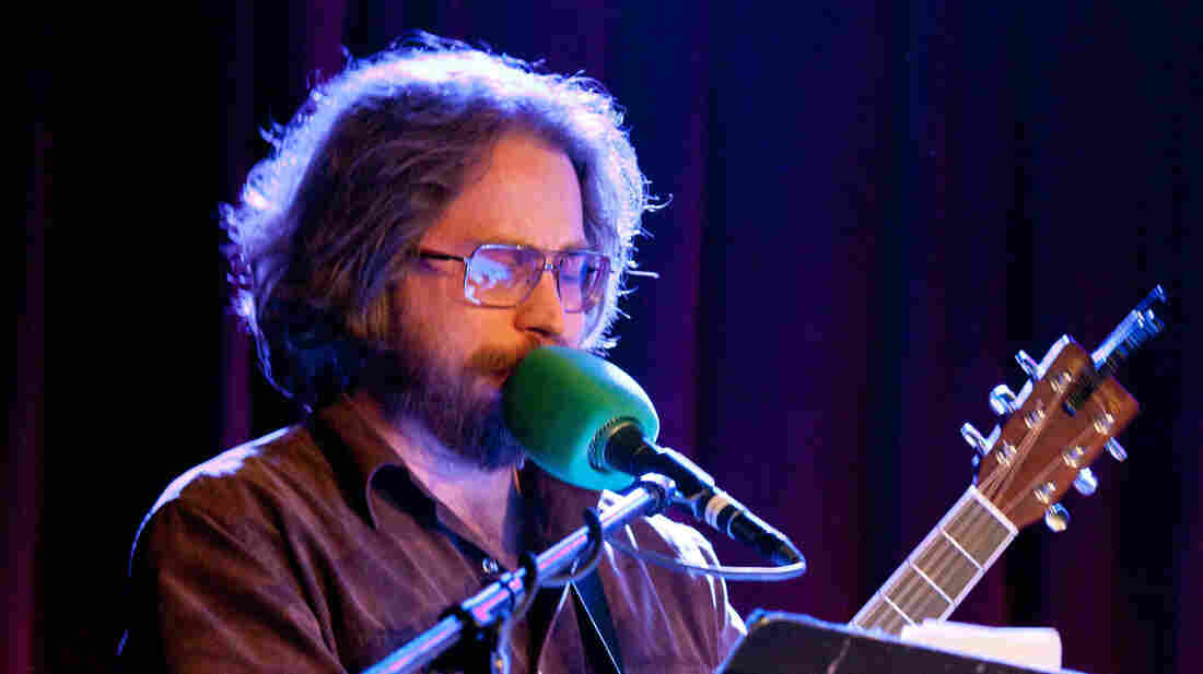 "House musician Jonathan Coulton works his way through a rendition of the Twisted Sister anthem ""We're Not Gonna Take It""...although its lyrics have been reworked as clues to baked goods."