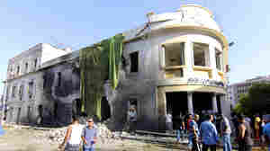 People gather at the site of a car bombing in Benghazi, Libya, on Wednesday — one year to the date after an attack on the U.S. consulate in the city killed the ambassador and three other Americans.