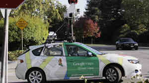 An employee drives a Google Maps Street View car around Palo Alto, Calif. The U.S. Court of Appeals in San Francisco said Tuesday that Google went far beyond listening to accessible radio communication when it drew information from inside people's homes.
