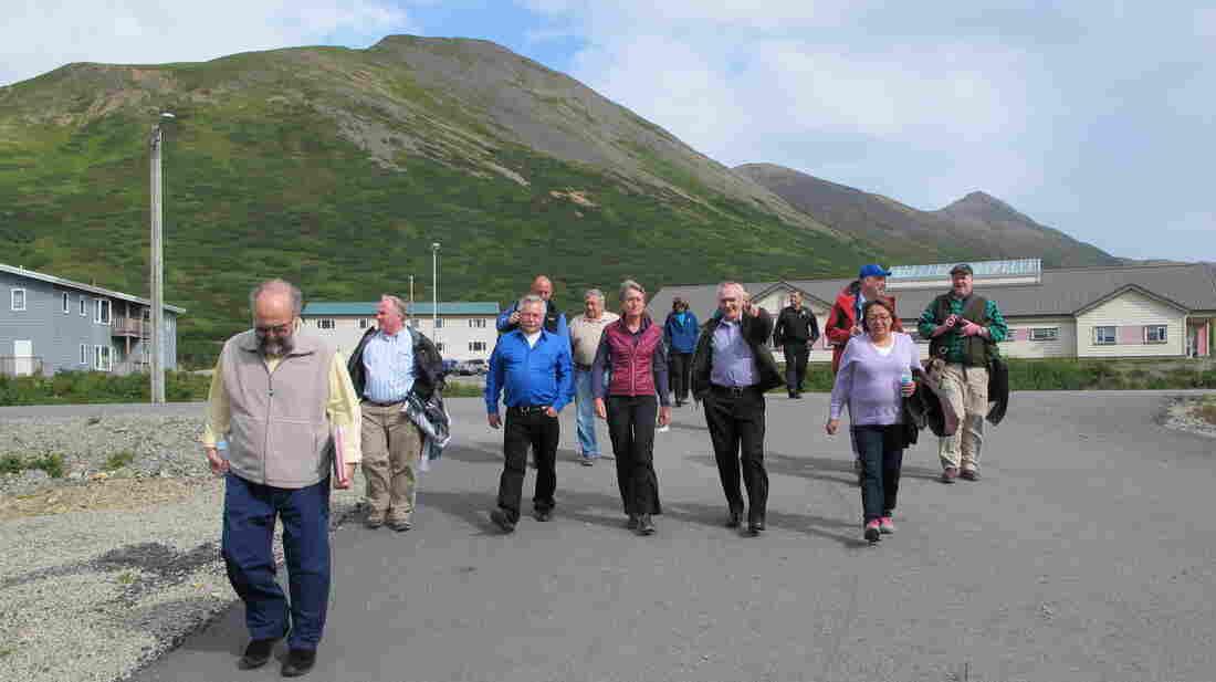Interior Secretary Sally Jewell (center) gets a tour of King Cove, Alaska.
