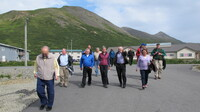 Interior Secretary Sally Jewell (center) gets a tour of King Cove, Alaska.