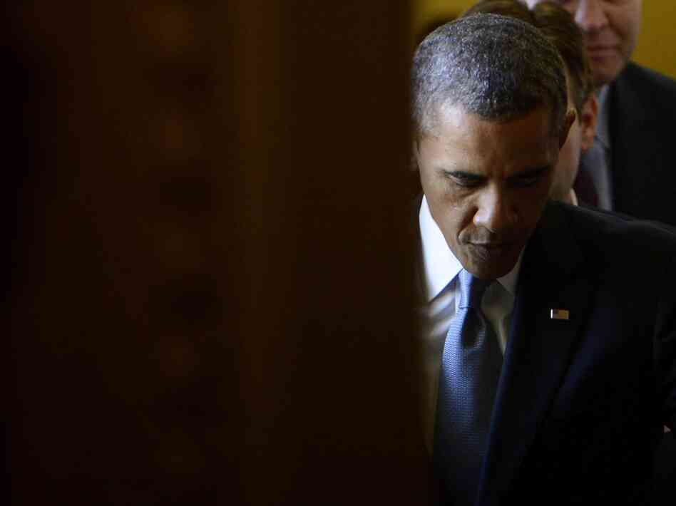 President Obama walks out of a meeting with the Senate Democratic Caucus at the Capitol on Tuesday.
