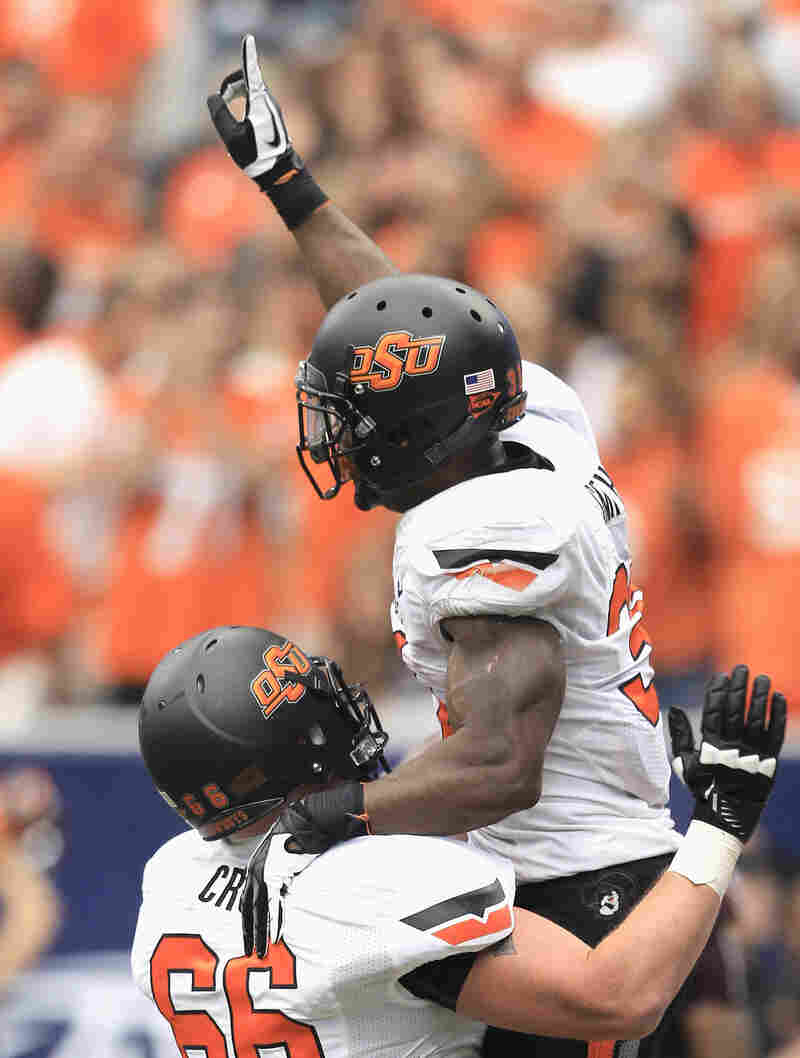 Oklahoma State players celebrate after a score during an Aug. 31 game against Mississippi State.