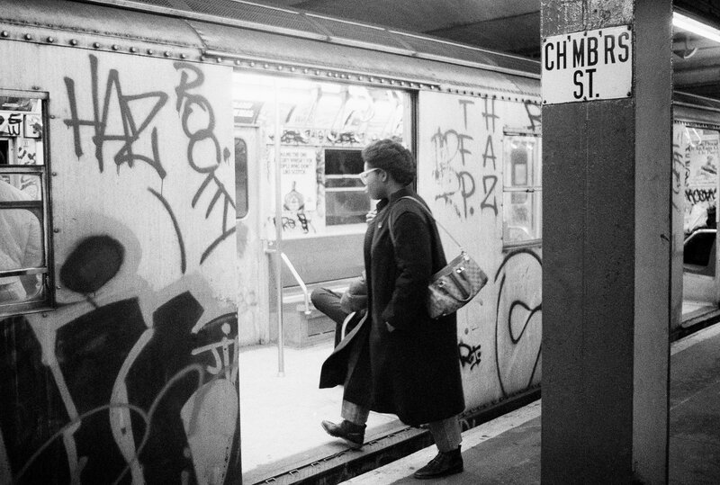 A passenger boards a subway car painted with graffiti, in New York in 1984.