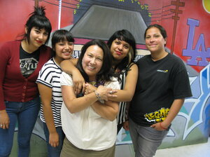 Evangeline Ordaz (center) stands with teens from Legacy LA who were her script consultants and extras for East Los High. From left: Rebecca Hernandez, Brenda Flores, Ordaz, Wesley Michua, Marlene Arazo.